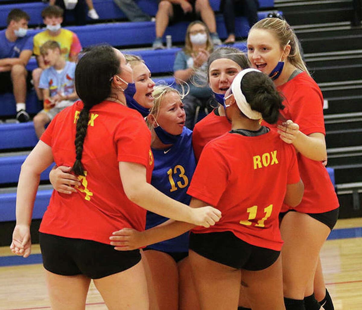 The Roxana Shells celebrate a point during their match against CM on Tuesday at the Roxana Tournament. The Shells lost to the Eagles, but bounced back to win their final two matches in pool play.