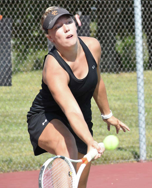 Edwardsville's Hannah Colbert reaches down for a shot during the Class 2A Edwardsville Sectional last season.