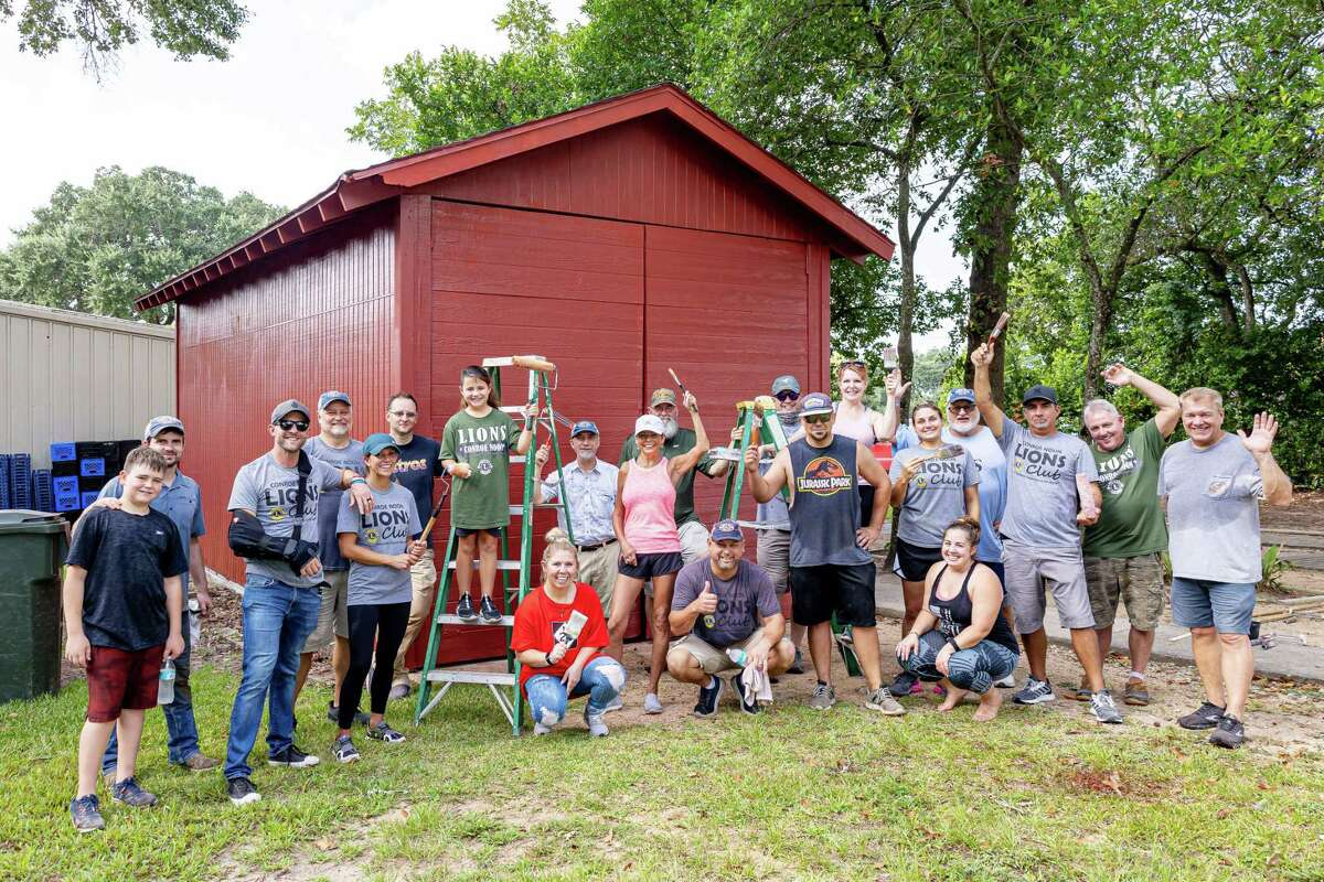 Last weekend 20+ members of the Conroe Noon Lions Club held a work day at the Community Assistant Center where they caulked, painted, and helped repair a drainage problem as part of their Service Saturday program.