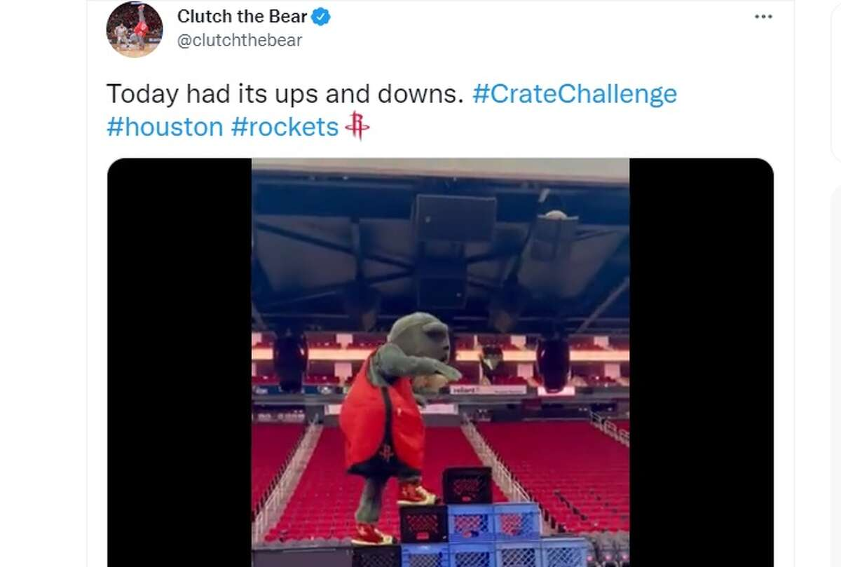 Clutch the Bear of the Houston Rockets completes the milk crate challenge.
