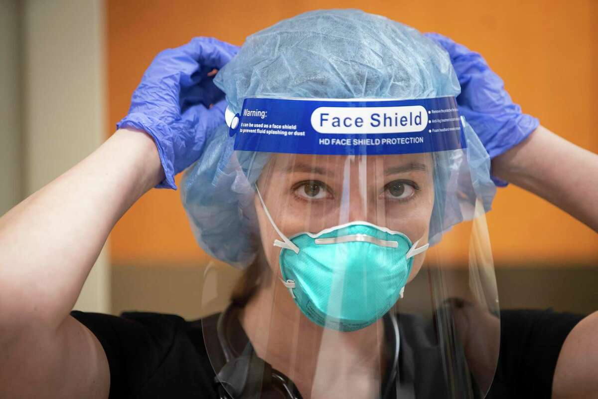 Dr. Nicole Zeisig, a hospitalist at Memorial Hermann Sugar Land Hospital, prepares to make rounds, Wednesday, Aug. 25, 2021, in Sugar Land. Dr. Zeisig recently penned an essay about the frustrations of working during the pandemic.