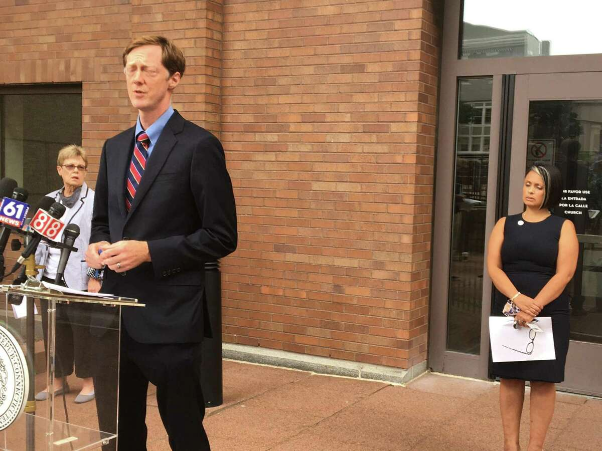 Mayor Justin Elicker on Aug. 27, 2021 announced a COVID-19 vaccine or testing mandate for 2,000 city employees. With him are Corporation Counsel Patricia King, left, and Director of Health Maritza Bond, right.