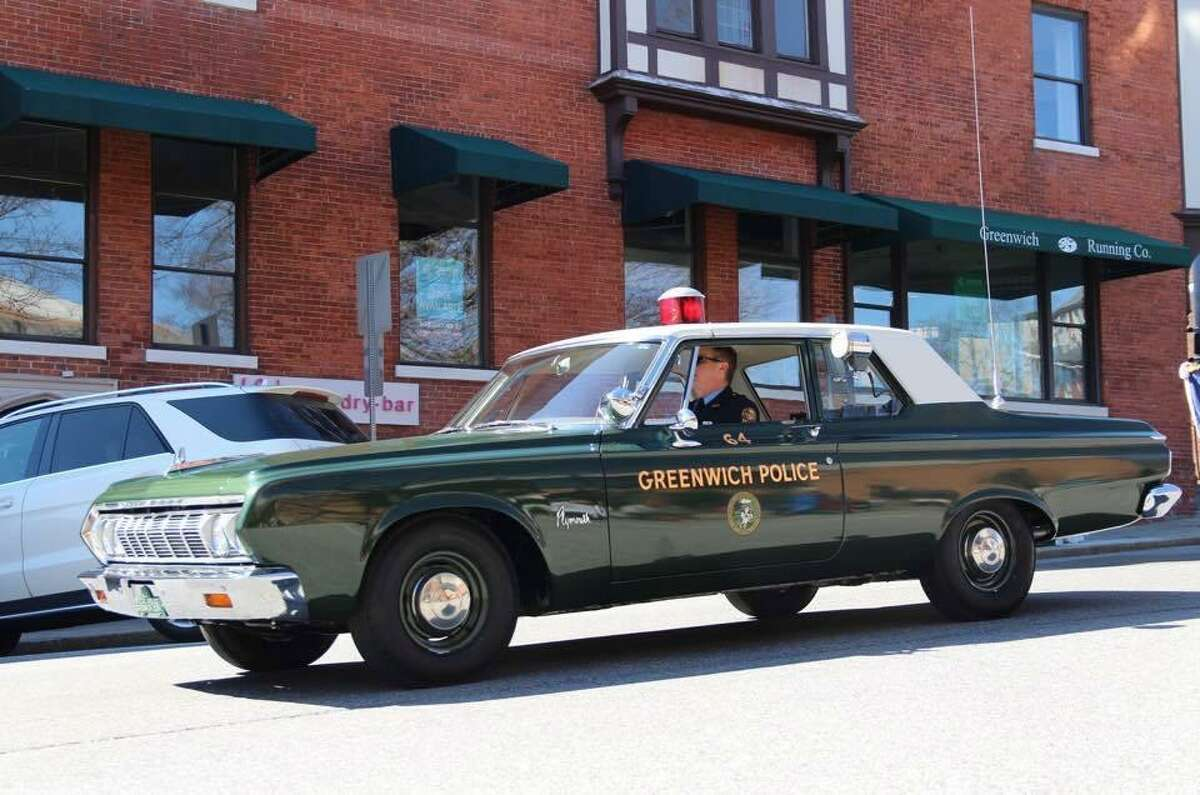 A 1964 Plymouth owned by retired officer and current Greenwich Police dispatcher Mark Wilson.