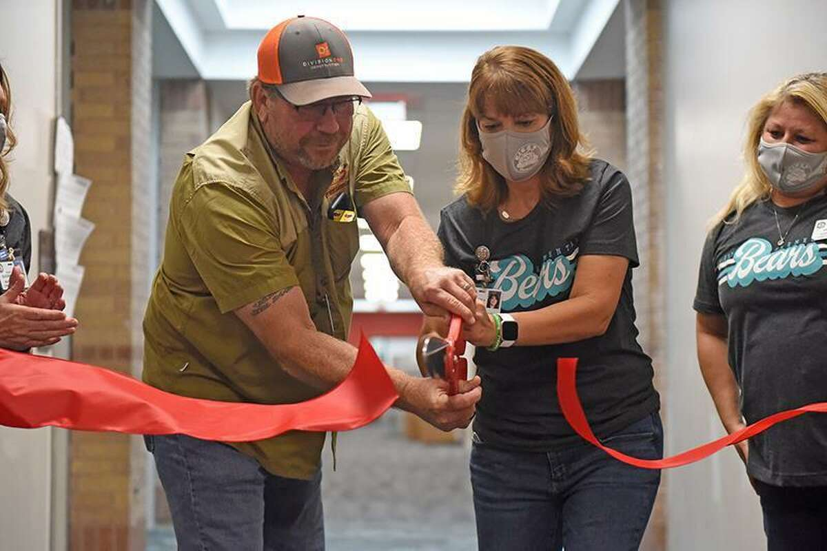 Ron Landreth, left, DivisionOne Construction project superintendent, and Dr. Jeanette Gerault, Fiest Elementary School principal, cut a red ribbon officially welcoming Fiest teachers and staff to the newly renovated campus on Aug. 16. Fiest has undergone renovations throughout the summer, including new safety and security upgrades and furniture throughout the building. Part of the new renovations to Fiest include a new kitchen, equipped with new serving lines and more space.