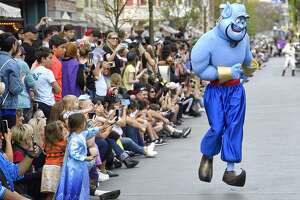 """The Genie from """"Aladdin"""" during a parade at Disneyland on Feb 27, 2020."""