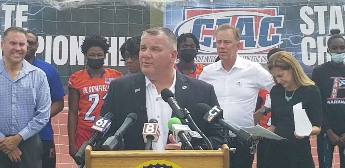 CIAC executive director Glenn Lungarini speaks at a press conference held at Willow Brook Park's Veterans Stadium on Aug. 17 encouraging student-athletes to get the COVID-19 vaccination. In the background is Gov. Ned Lamont. Lungarini says that the CIAC will not be extending the regular season due to COVID postponements.