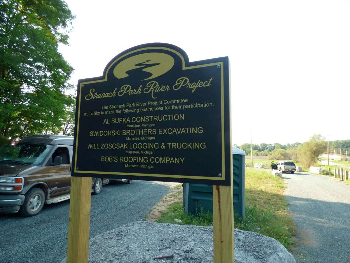 A sign erected in Stronach Township thanks a number of local businesses and anonymous volunteers who made a slew of improvements to an egress along the Little Manistee River.(Scott Fraley/News Advocate)
