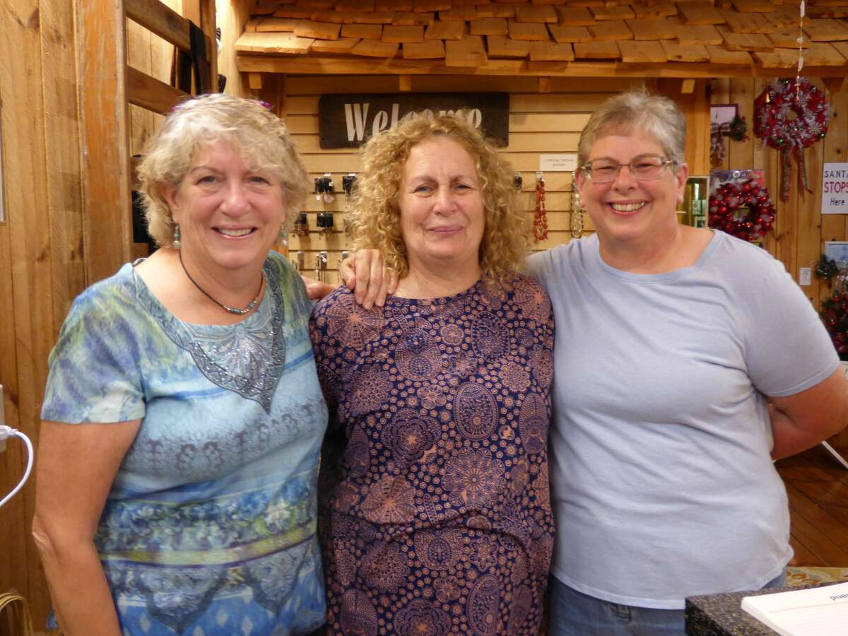 Three sisters (from left) Libby Zilke, Mickey Swinehart and Frankie Rasnick recently opened Three Peas in a Pod, a new Manistee business that sells their artwork, crafts and home décor.