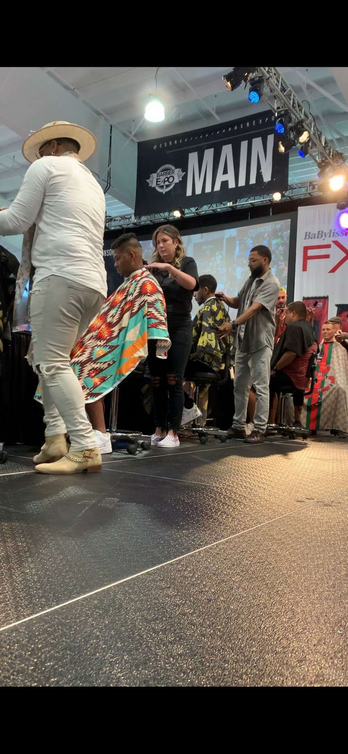"""Groom barbers Amy Pozzo and Brock Sanford participated in the 10th annual CT Barber Expo at Mohegan Sun Aug. 16-17. Each competed in a different category, Pozzo, pictured, was the only woman in the """"15 minute fade"""" contest."""