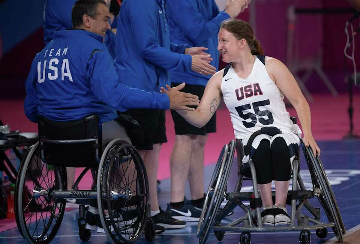U.S. women's coach Trooper Johnson greets Courtney Ryan before the team's win over Chile at the Lima 2019 Parapan American Games.