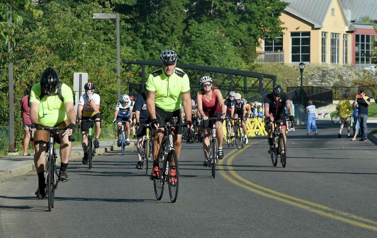 Riders begin the Folks on Spokes and Step Forward Memorial Walk in Milford on September 16, 2018. The ride and walk raised funds for Bridges Healthcare to support mental health and addiction recovery.