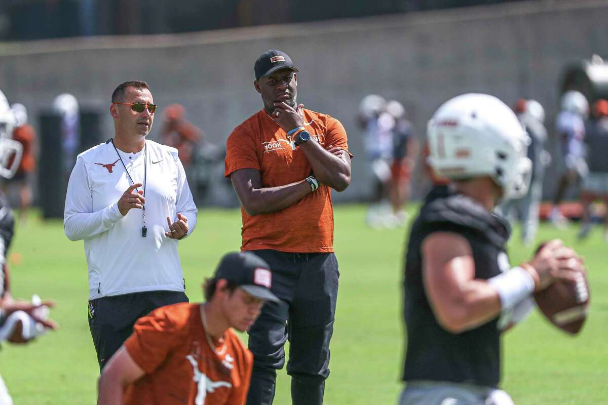 New coach Steve Sarkisian was brought to Texas to take the Longhorns back to heights not seen since Vince Young (center) led the 2005 team to the national championship.