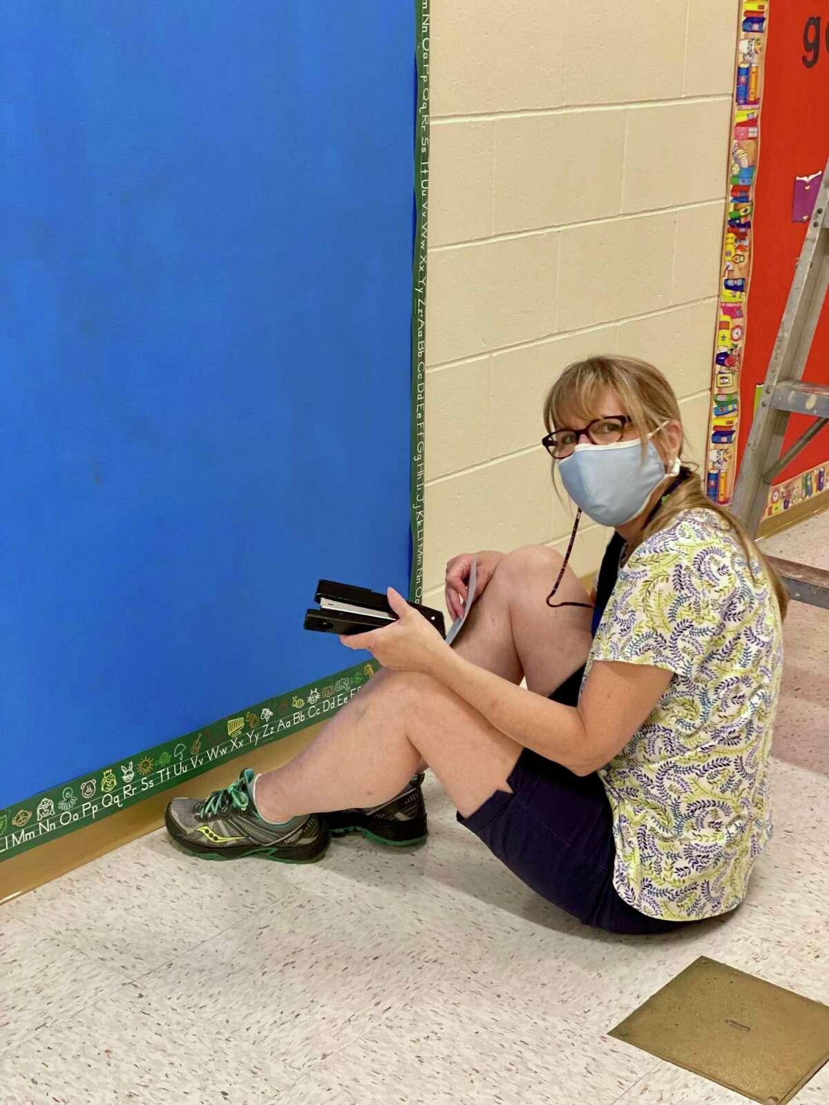 Teacher Melinda Violante works on her bulletin Scotland Elementary School teachers in Ridgefield set up their classrooms
