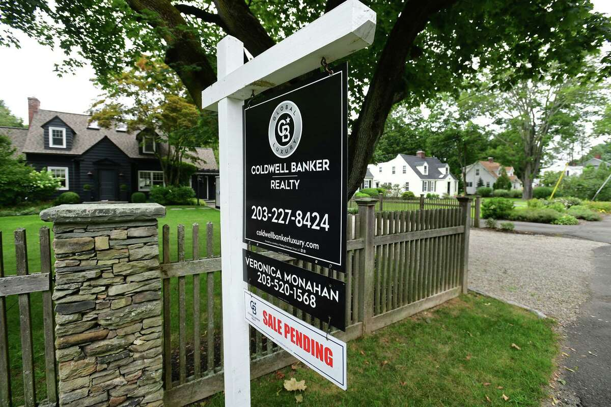A real estate sign on South Compo Road Tuesday, August 3, 2021, in Westport, Conn.
