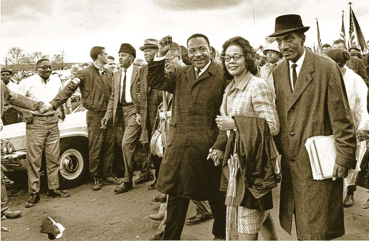 AssociatDr. Martin Luther King Jr., third from right and his wife, Coretta King, lead off the final lap to the state capitol at Montgomery, Ala. in this March 25, 1965 file photo. Thousands of civil rights marchers joined in the walk, which began in Selma, Ala., on March 21, demanding voter registration rights for blacks. Rev. D. F. Reese, of Selma, is at right.ed Press archive