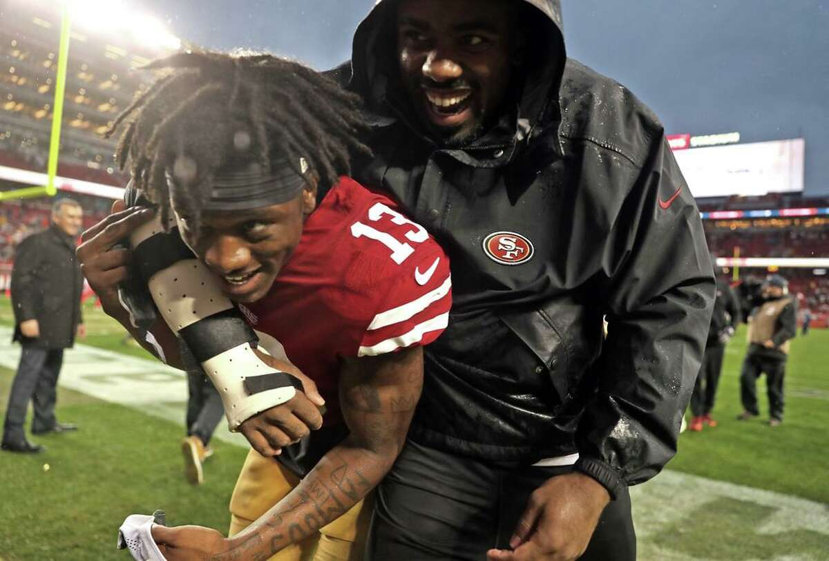 San Francisco 49ers' Richie James, Jr. gets a hug as he leaves the field after Niners' 26-23 win over Seattle Seahawks in overtime in NFL game at Levi's Stadium in Santa Clara, Calif. on Sunday, December 16, 2018.