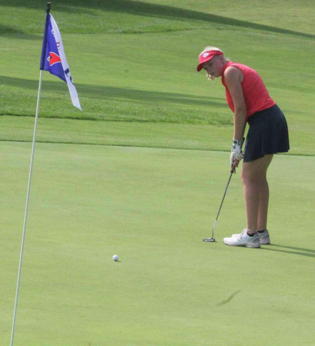 Chippewa Hills' Kerstin Stadtfeld, of Chippewa Hills, watches her putt at Katke Golf Course during Friday's Cardinal Invitational. (Pioneer photo/John Raffel)