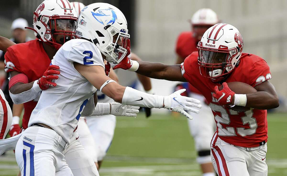 Katy running back Seth Davis, right, fends off Clear Springs defensive back Brennan Winter (2) during the first half of a high school football game, Friday, Aug. 27, 2021, in Katy.