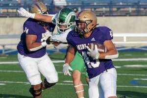 Midland High's JacobUrias looks for more yards against El Paso Montwood 08/27/2021 at Grande Communications Stadium. Tim Fischer/Reporter-Telegram