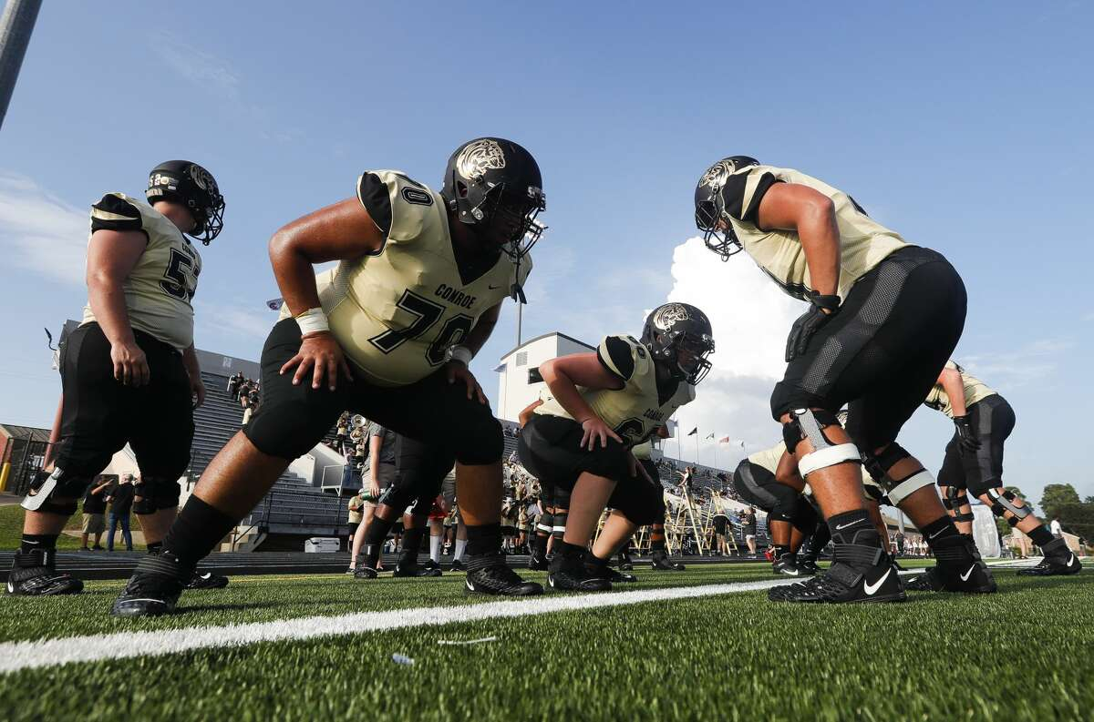 Conroe players warm up before a non-district high school football game at Buddy Moorhead Stadium, Friday, Aug. 27, 2021, in Conroe.