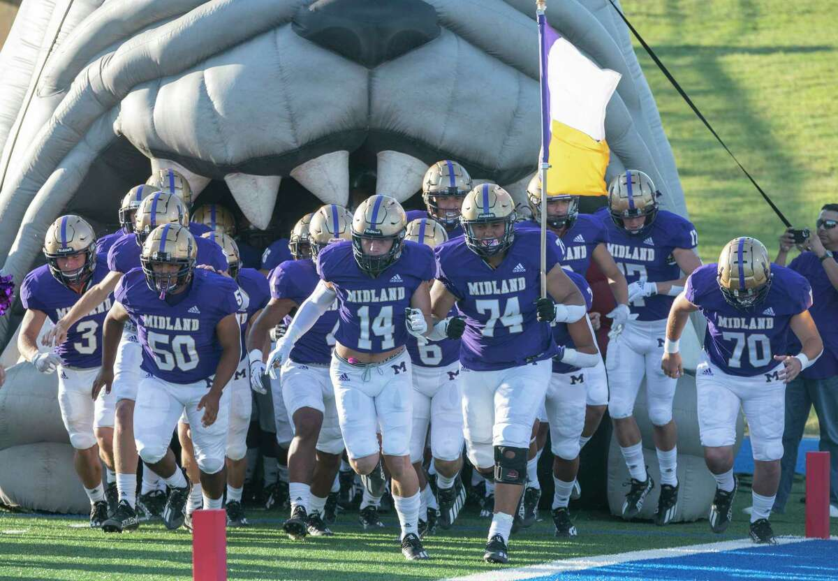 Midland High players make their way onto the field 08/27/2021 at Grande Communications Stadium as they take on El Paso Montwood. Tim Fischer/Reporter-Telegram