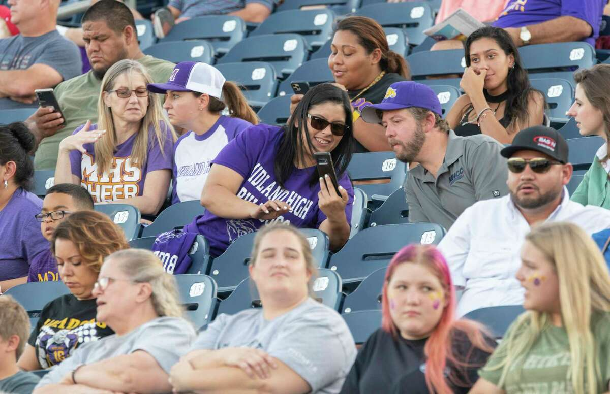 Midland High fans cheer on their team 08/27/2021 at Grande Communications Stadium as they take on El Paso Montwood. Tim Fischer/Reporter-Telegram