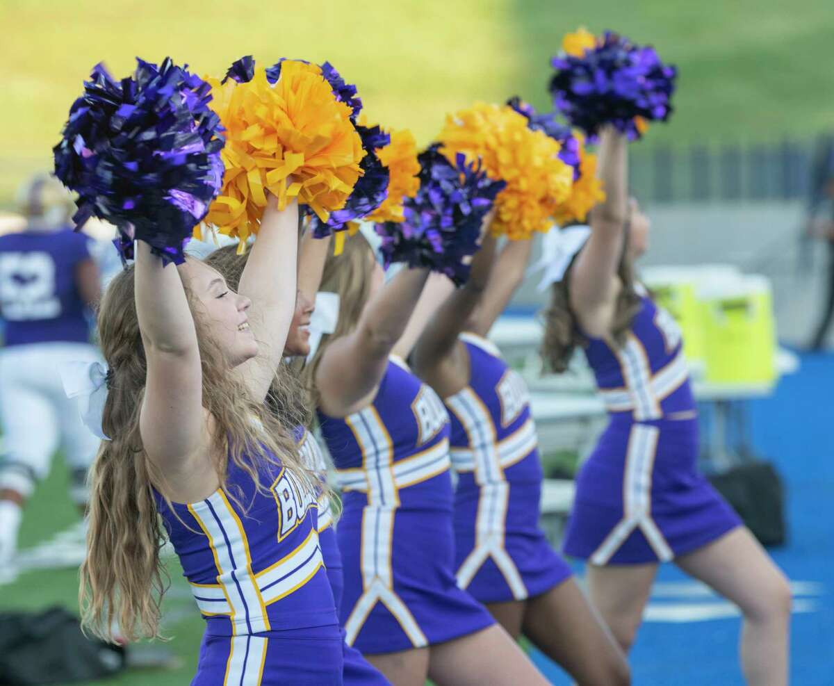 Midland High cheerleaders cheer on their team 08/27/2021 at Grande Communications Stadium as they take on El Paso Montwood. Tim Fischer/Reporter-Telegram