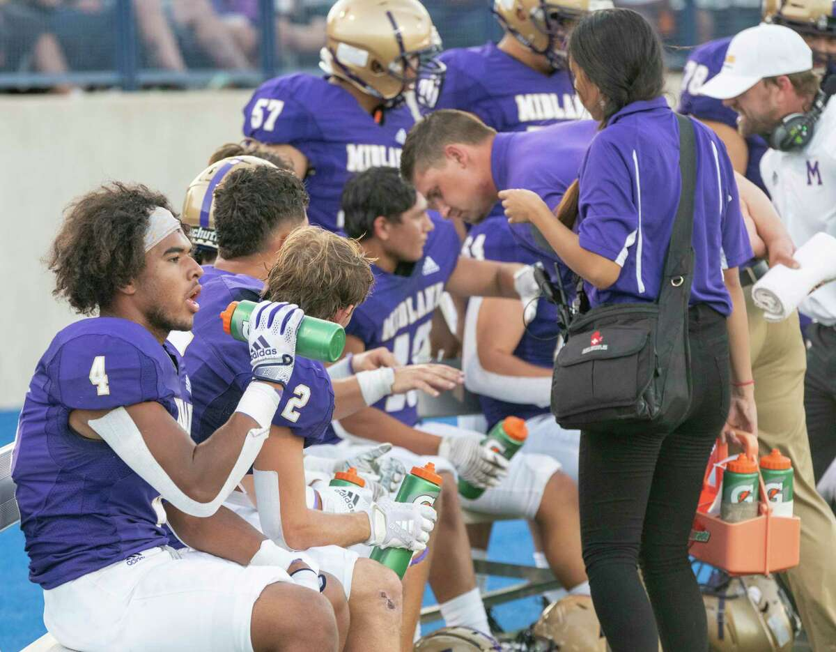 Midland High offense gets a break after scoring a touchdown 08/27/2021 at Grande Communications Stadium as they take on El Paso Montwood. Tim Fischer/Reporter-Telegram