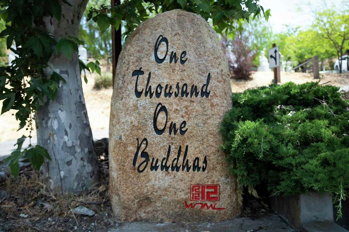 """A sign greets guests to the Temple of 1001 Buddhas in Fremont, Calif. Wednesday, June 16, 2021. Fremont wants the owners who built the """"Temple of 1001 Buddhas,"""" allegedly without proper permits, to tear the buildings down. The property owners say that's a violation of their civil rights and are suing the city. San Francisco's Angela Alioto has taken the case."""