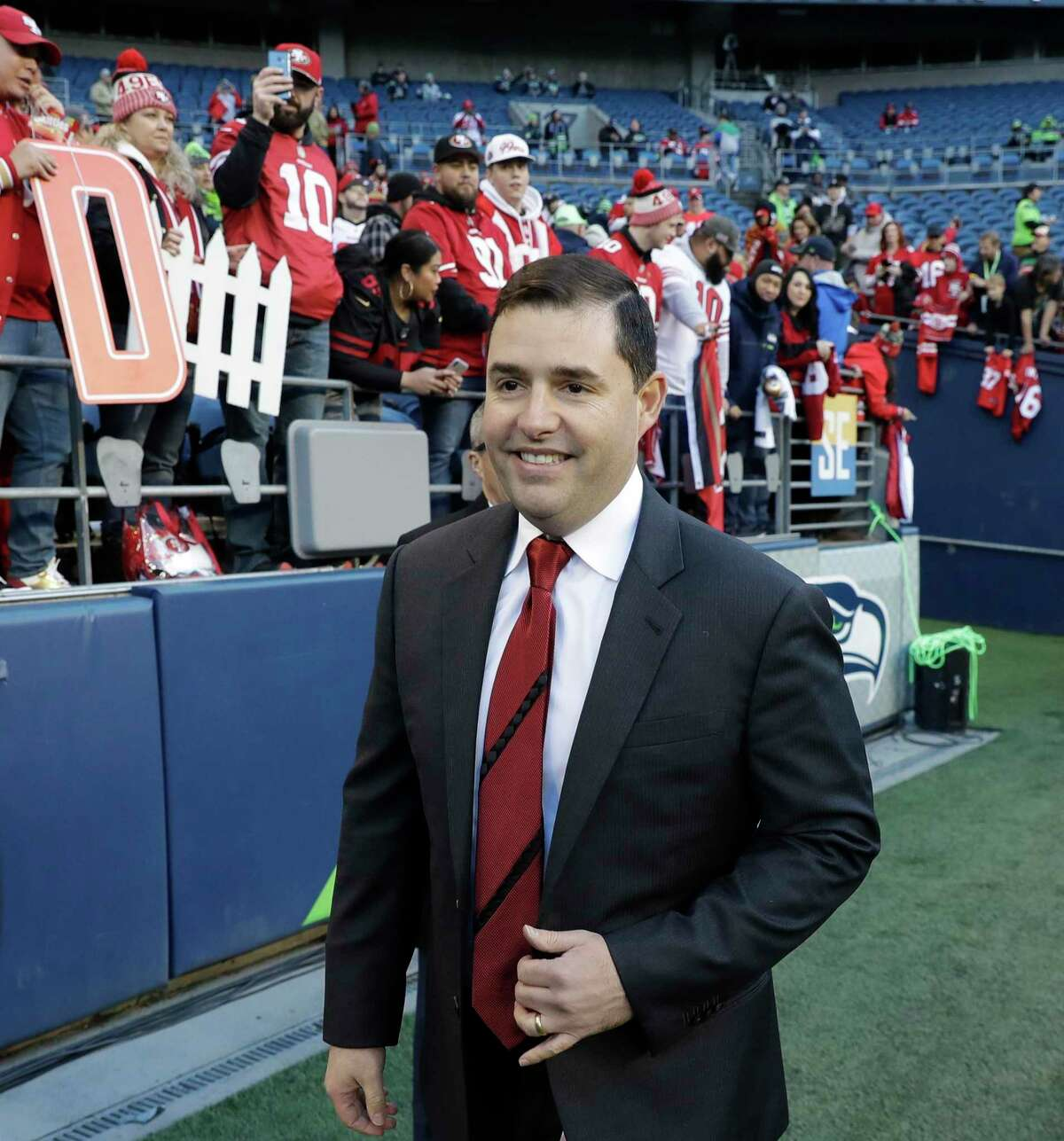 San Francisco 49ers team owner Jed York walks on the field before an NFL football game against the Seattle Seahawks, Sunday, Dec. 29, 2019, in Seattle. (AP Photo/Ted S. Warren)