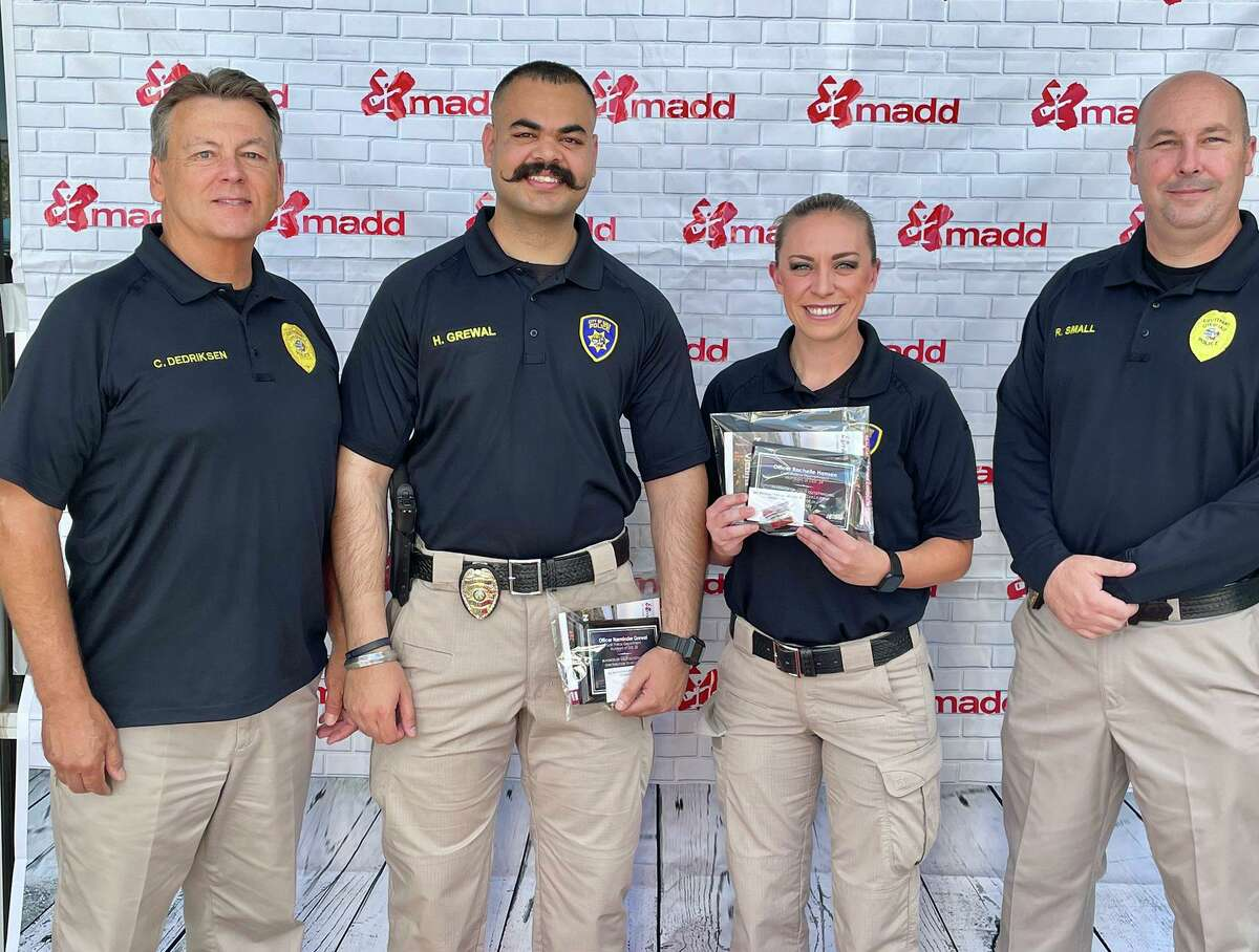 Off. Harminder Grewal, second from left, died days after the patrol car he and his partner were riding in was struck head-on by another vehicle on Highway 99 in Elk Grove while responding to the Caldor Fire, authorities said. Grewal is pictured after receiving recognition from by the California's Mothers Against Drunk Driving organization in July 2021.