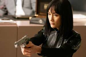 """This image released by Lionsgate shows Maggie Q in a scene from """"The Protégé."""""""