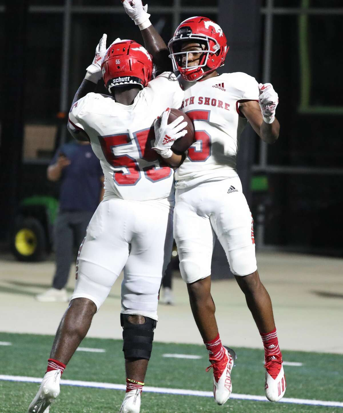 North Shore's Jacoby Davis (5) celebrates after scoring a touchdown after intercepting a pass thrown by Shadow Creek's QB Duke Butler (7) during the second half of a high school football game at Freedom Field, Friday, August 27, 2021, in Iowa Colony.