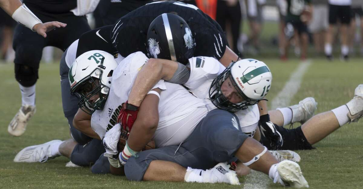 The Woodlands Christian Academy Ezekiel Jurado (79) recovers a fumble during the first quarter of a non-district football game against Legacy Prep Christian Academy at Holcomb Family Field, Friday, Aug. 27, 2021, in Magnolia.