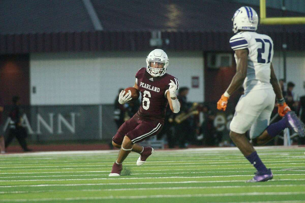 Pearland's Dominic Serna (6) finds running room against Ridge Point Friday at The Rig in Pearland.