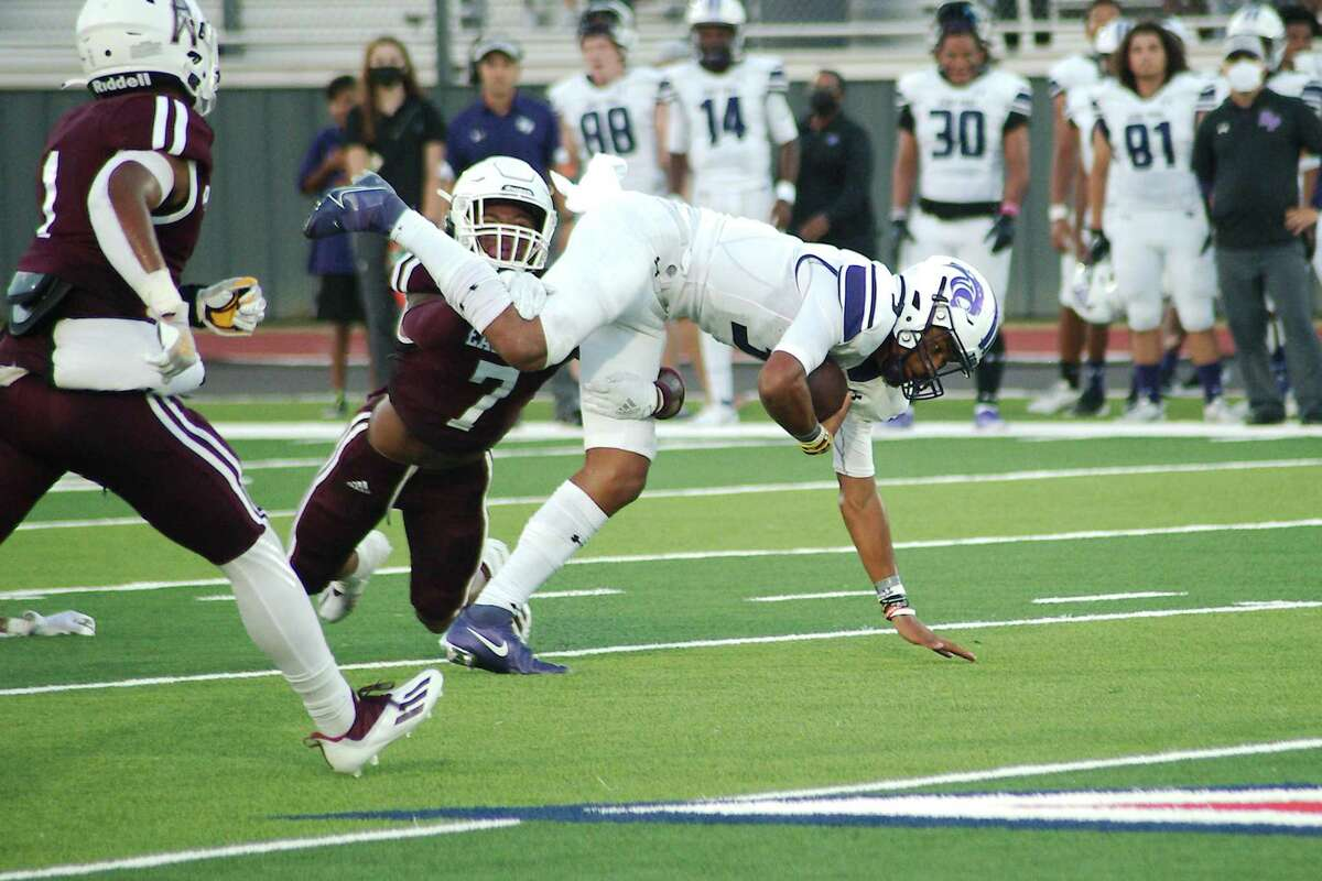 Ridge Point's Bert Emmanuel Jr. (3) is tripped up by Pearland's Dylan Dixson (7) Friday at The Rig in Pearland.