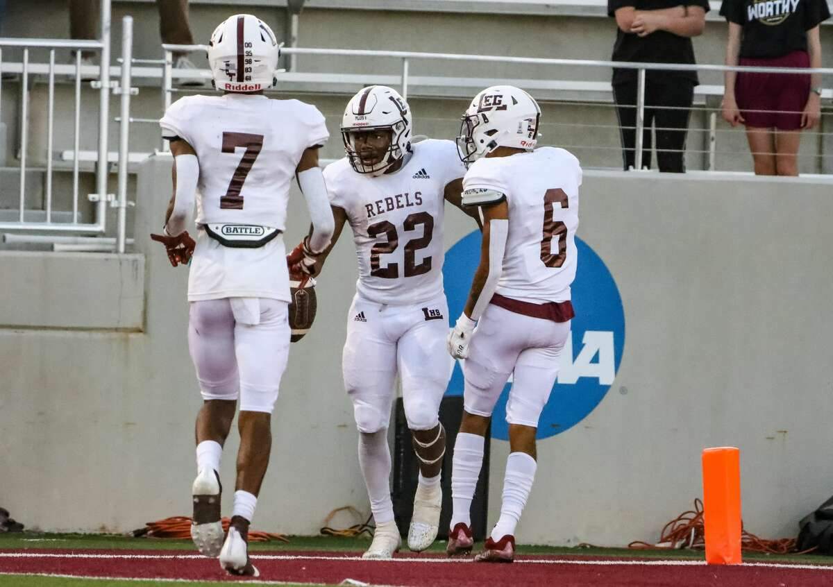 Legacy High School's Makhilyn Young celebrates with Michael Valles (6) and Chris Brazzell (7) during the game against Amarillo High on Aug. 24, 2021. Legacy will replace LEG decals see here with LHS stickers.