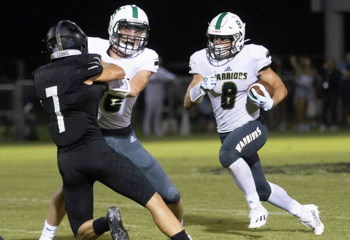 The Woodlands Christian Academy wide receiver Blake Wiley (8) runs the ball while protected from Legacy Prep Christian Academy's Luke Sigler (7) during the third quarter of a non-district football game at Holcomb Family Field, Friday, Aug. 27, 2021, in Magnolia.