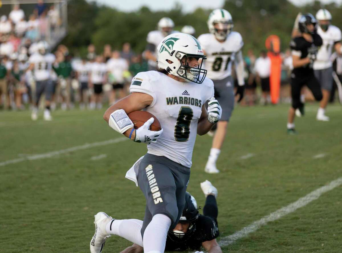 The Woodlands Christian Academy wide receiver (8) runs the bal during the first quarter of a non-district football game against Legacy Prep Christian Academy at Holcomb Family Field, Friday, Aug. 27, 2021, in Magnolia.