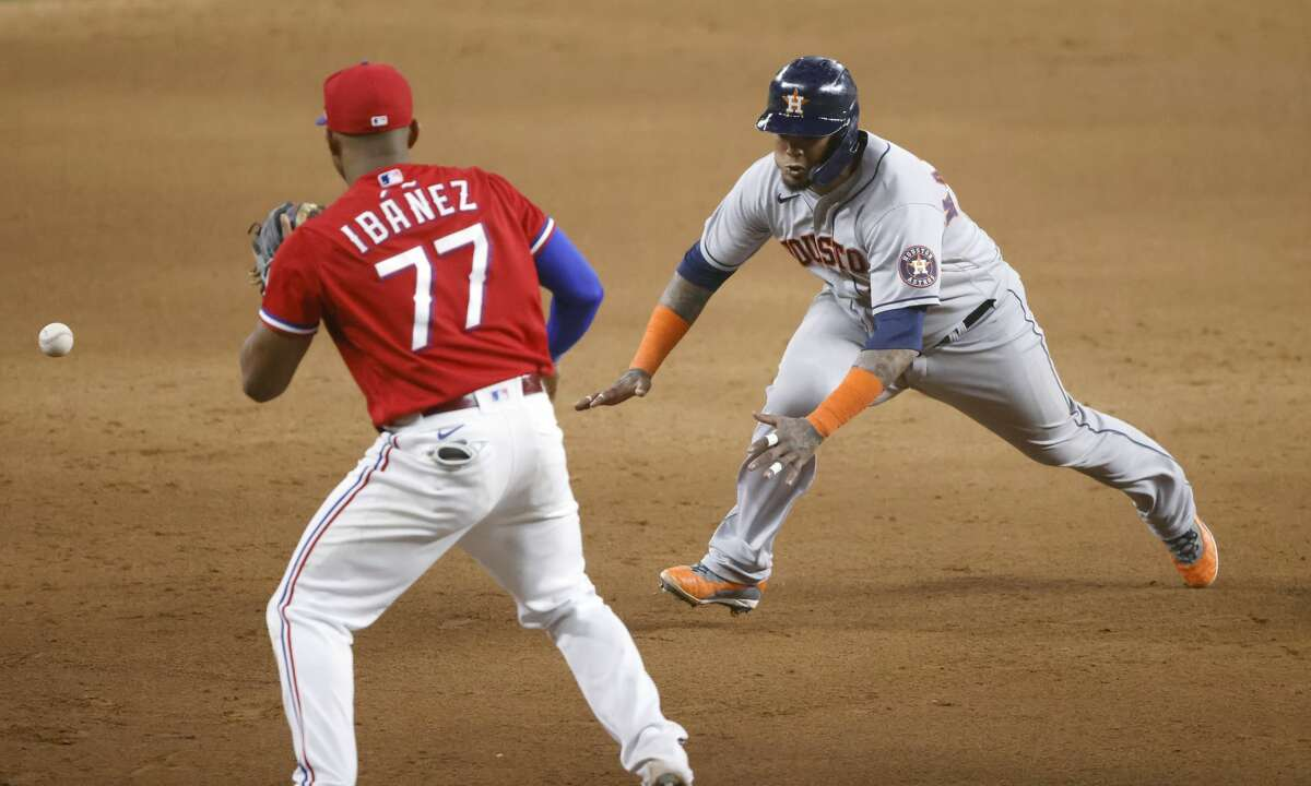 ARLINGTON, TX - AUGUST 27: Martin Maldonado #15 of the Houston Astros runs to third base as Andy Ibanez #77 of the Texas Rangers waits for the the throw during the seventh inning at Globe Life Field on August 27, 2021 in Arlington, Texas. (Photo by Ron Jenkins/Getty Images)