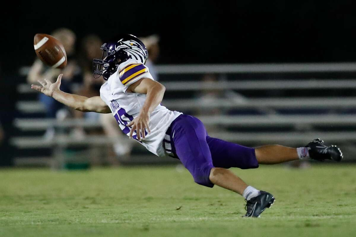 Kinkaid Falcons Miles Roeder (20) dives in an attempt to intercept a pass in the fourth quarter of the high school football game between the Kinkaid Falcons and the Second Baptist Eagles at Eagle Stadium in Houston, TX on Friday, August 27, 2021. The Falcons defeated the Eagles 21-14.