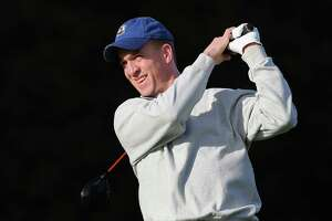 Peyton Manning, who was then the Denver Broncos quarterback, hits a tee shot during a practice round for the AT&T Pebble Beach National Pro-Am at Pebble Beach Golf Links on Feb. 5, 2014, in Pebble Beach, Calif.