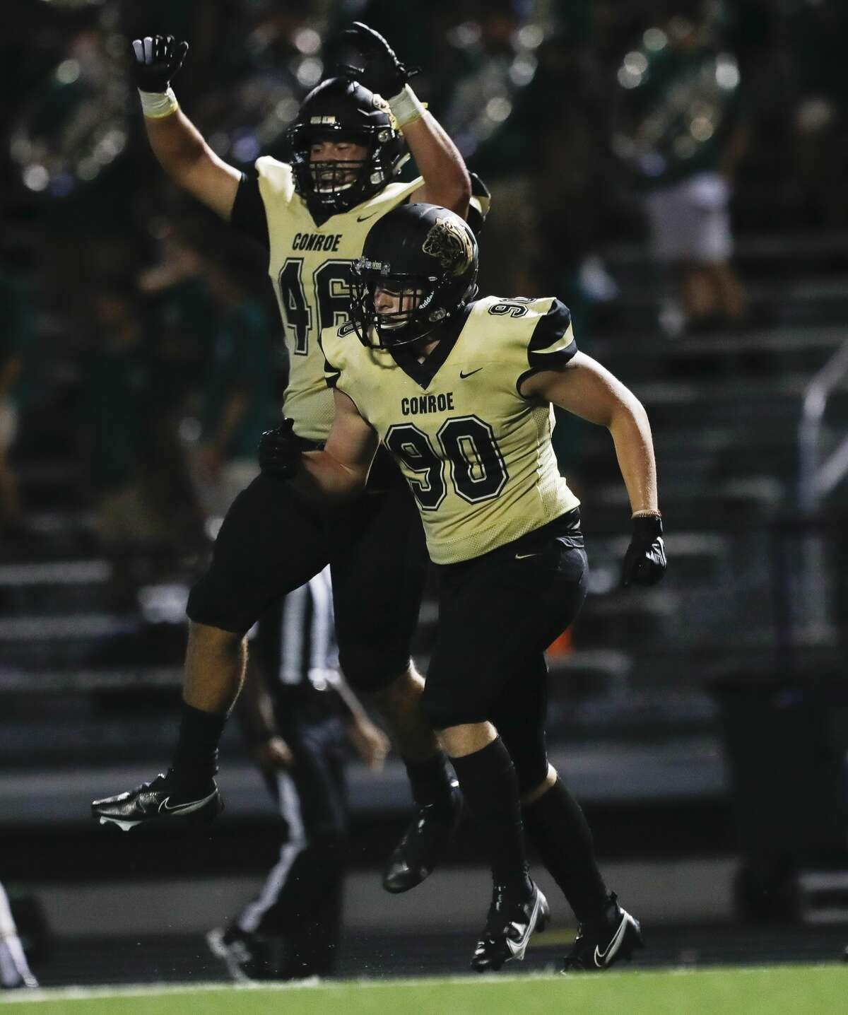 Conroe defensive lineman Matthew Westmoreland (90) reacts after returning a interception for a 45-yard touchdown during the third quarter of a non-district high school football game at Buddy Moorhead Stadium, Friday, Aug. 27, 2021, in Conroe.