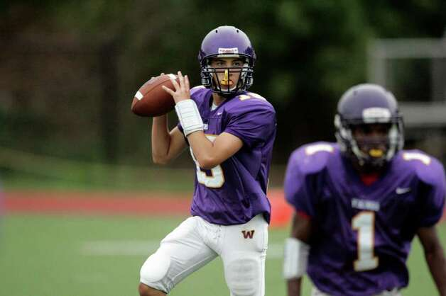 Westhill High School quarterback Peter Cernansky rolls to his right while looking for an open receiver during action against Harding High School on Thursday September 16, 2010. Photo: J. Gregory Raymond / Stamford Advocate Freelance;  © J. Gregory Raymond/for The Advocate