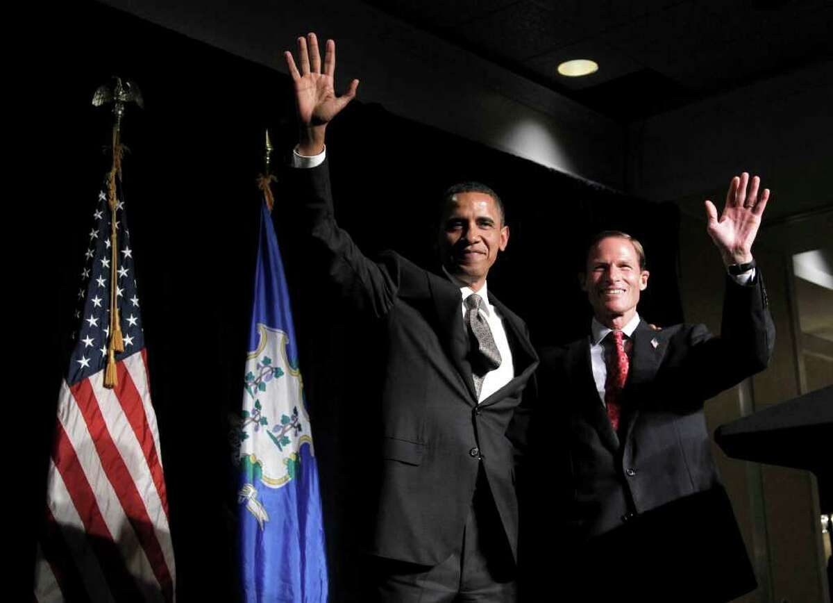 President Barack Obama, left, with Connecticut Attorney General and Democrat candidate for US Senate Richard Blumenthal, right, wave during a fundraiser in Stamford, Conn., Thursday, Sept. 16, 2010. Blumenthal is running in the Nov. 2 general election to fill the seat being vacated by the retirement of Sen. Christopher Dodd, D-Conn. (AP Photo/Pablo Martinez Monsivais)