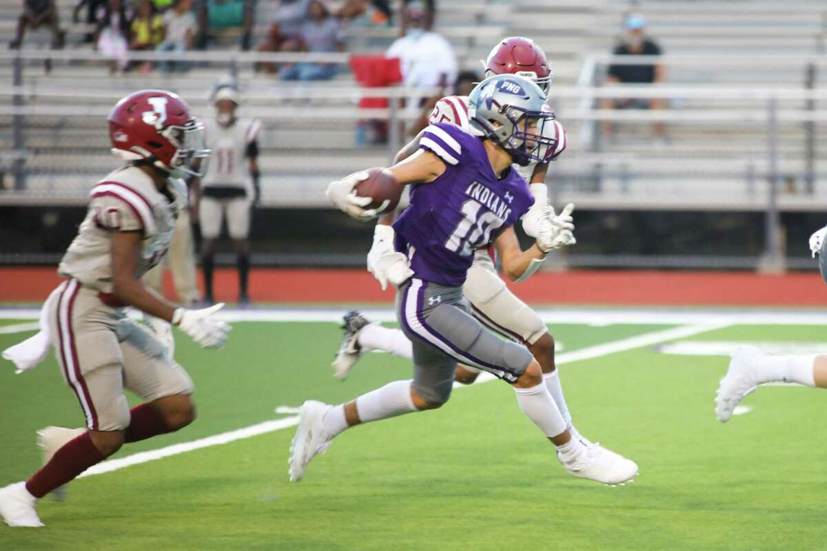 Port Neches-Groves' Landon Guarnere (10) heads upfield after a first-quarter reception from Cole Crippen (not pictured) during an Indians' scoring drive against Jasper in their season-opening game at Indian Stadium in Port Neches.