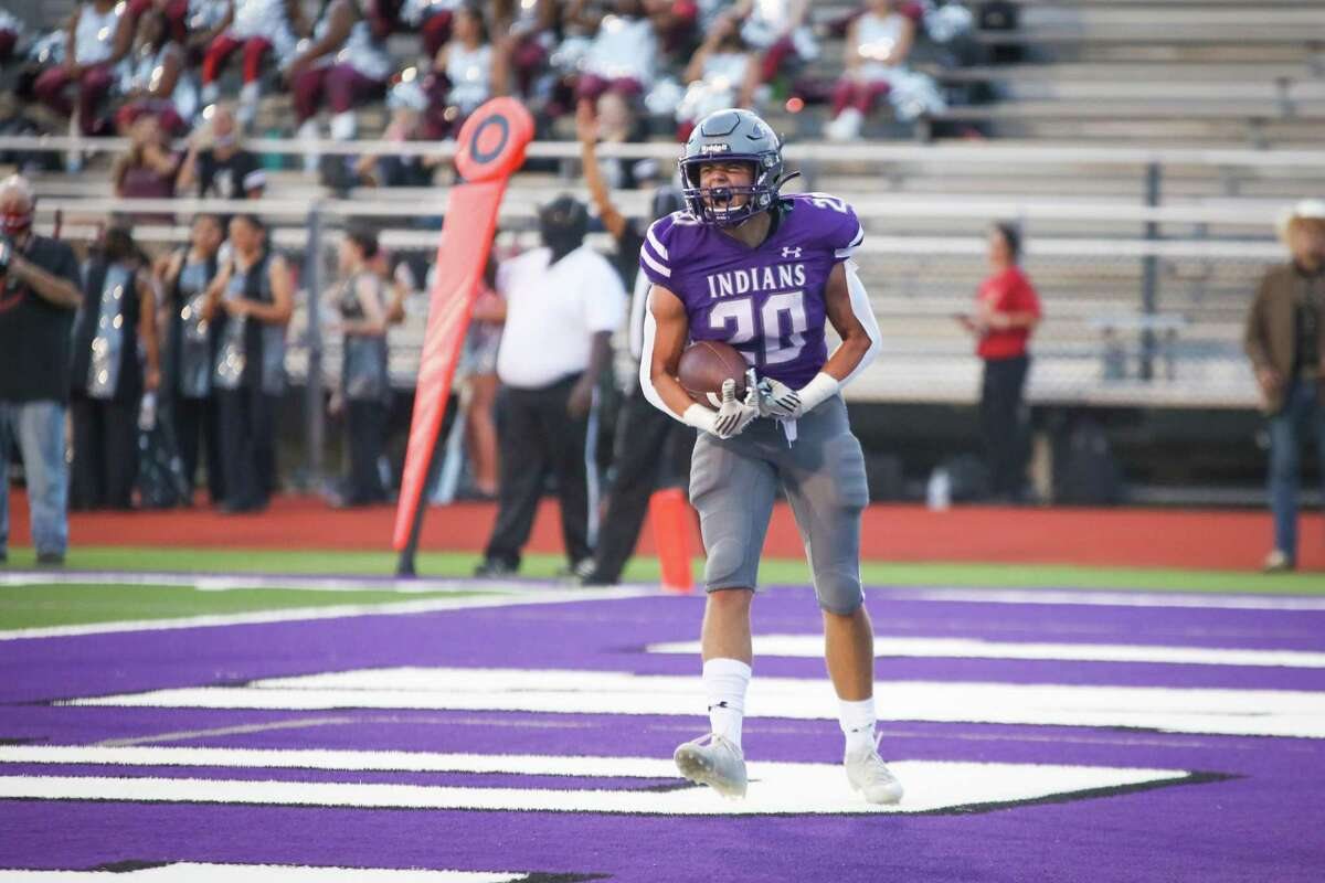Port Neches-Groves' Koby Trahan (20) reacts after a first-quarter score against Jasper in their season-opening game at Indian Stadium in Port Neches.