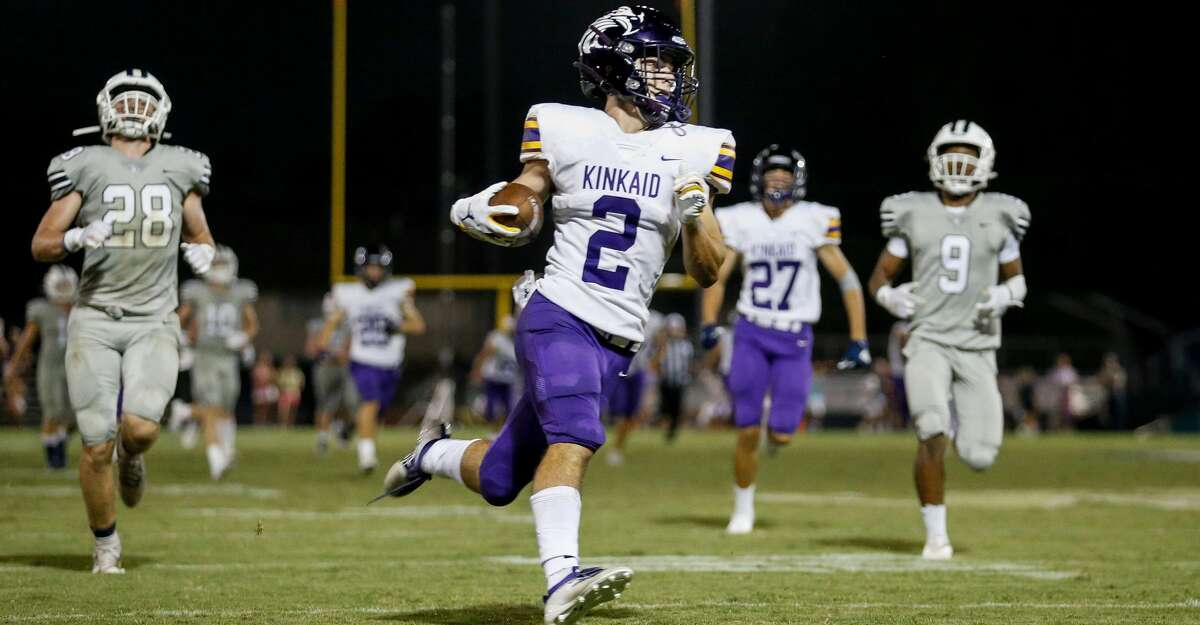 Kinkaid Falcons Alex Gottsegen (2) catches a pass and runs for a touchdown during the first half of the high school football game between the Kinkaid Falcons and the Second Baptist Eagles at Eagle Stadium in Houston, TX on Friday, August 27, 2021.