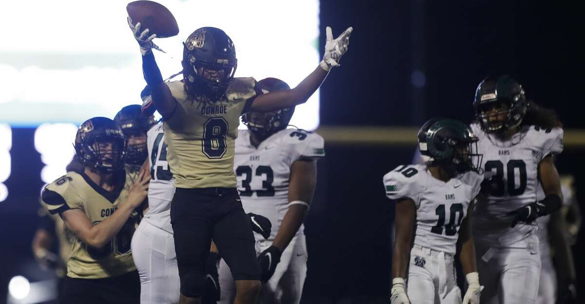 Conroe's Marcus Scott (8) reacts after recovering a muffed punt return during the third quarter of a non-district high school football game at Buddy Moorhead Stadium, Friday, Aug. 27, 2021, in Conroe.