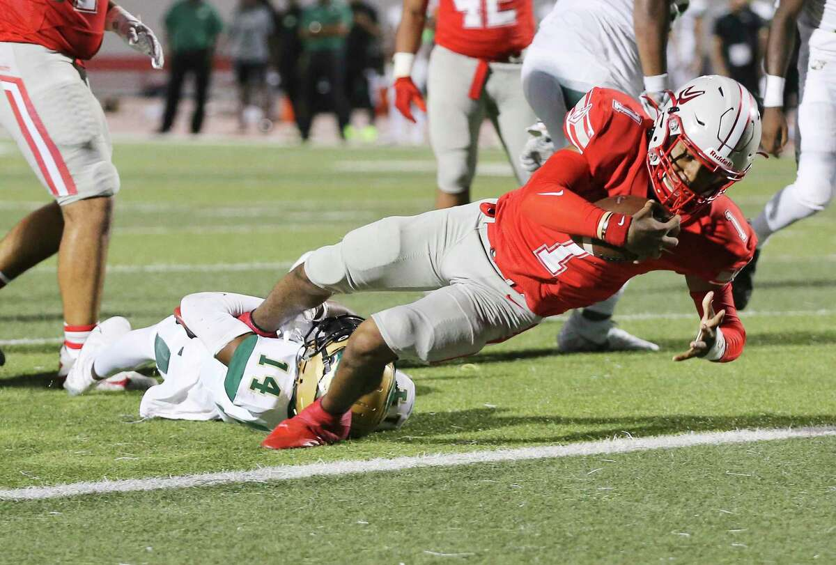 Judson quarterback Michael Burroughs (01) scores a short-yardage touchdown against DeSoto's DeMichael Porter (14) at Rutledge Stadium on Friday, Aug. 27, 2021.